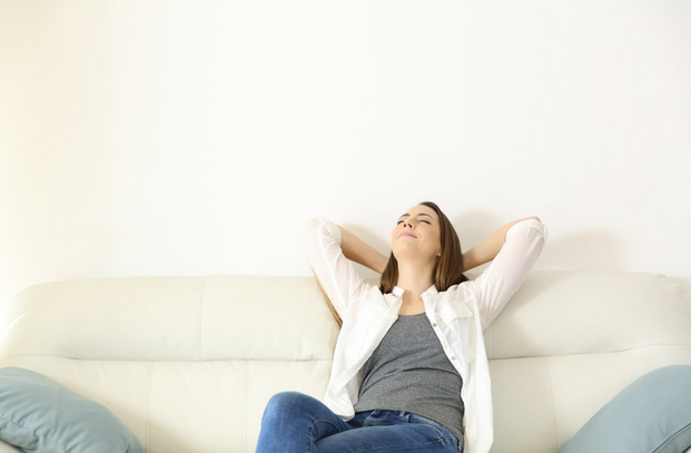 A woman enjoys a cool, comfortable room